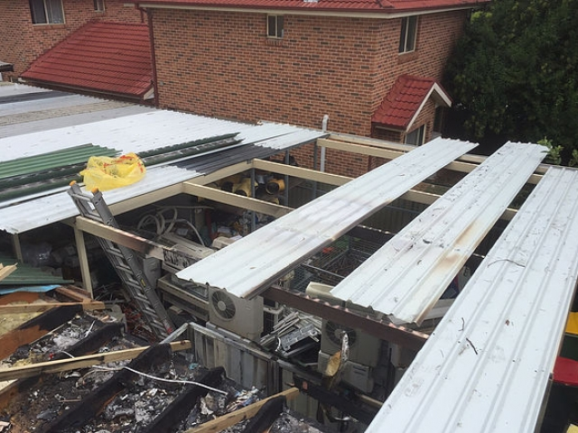 Fire damaged roof before
